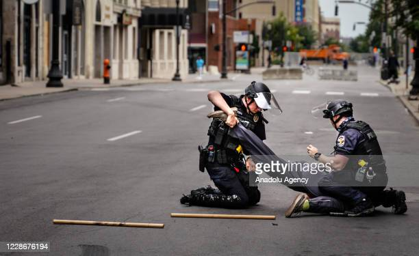 Riot police arrest protesters in Louisville, Kentucky, on September 23 after a judge announced the charges brought by a grand jury against Detective...
