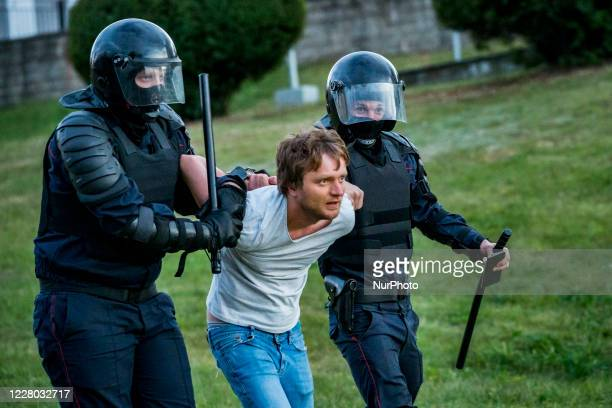 Riot police arrests a man in the streets of Minsk, Belarus, on August 11, 2020. There is a high presence of police, patrolling the city and arresting...