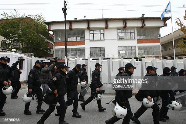 Riot police arrive as unseen Turkish protesters demonstrate against Israel's attack on Gaza outside the Israeli embassy in Ankara on November 21 2012...