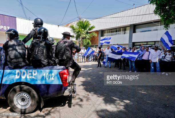 Riot police arrive at a parking lot where opposition protesters demonstrating against the government took refuge as police warned they will arrest...