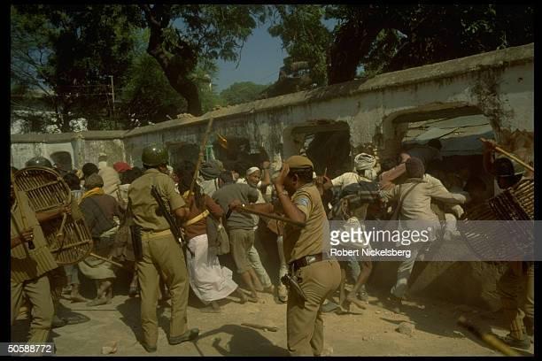 Riot police battling rampaging incited Hindus bent on razing Muslim mosque, Babri Masjid, & erecting Hindu temple to god-king Rama.