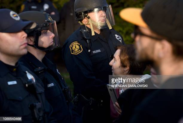 Riot police block protesters as they near the Tree of Life Congregation on October 30 2018 in Pittsburgh Pennsylvania Scores of protesters took to...