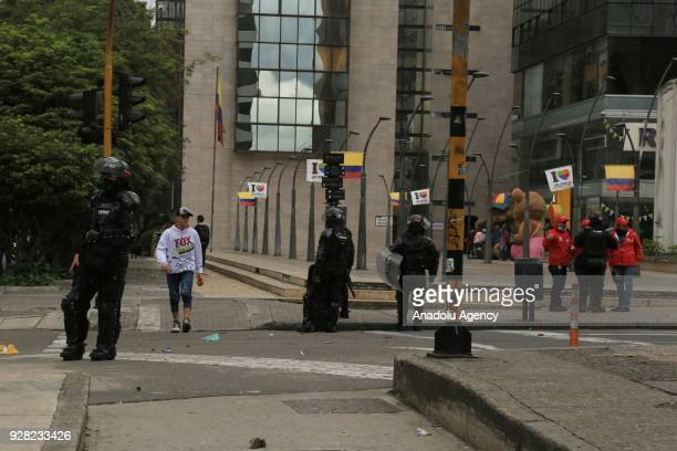 Riot police block the road as they attempt to disperse protestors after clashes broke out between students and riot police during a protest due to...