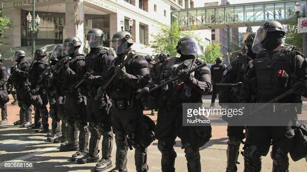 Riot police block the street during a free speech rally near Terry Schrunk Plaza in Portland Oregon on June 4 2017