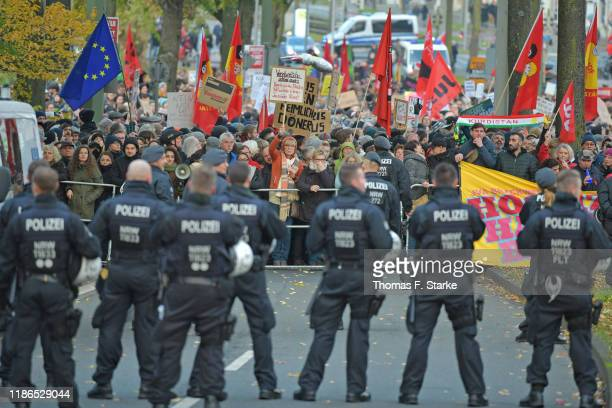 Riot police blocks counter protesters during a NeoNazis march in support of Holocuast denier Ursula Haverbeck on November 9 2019 in Bielefeld Germany...