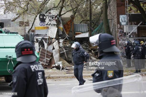 Riot police break the wall to enter the location of the left alternative site trailer Camp Kopi on October 15, 2021 in Berlin, Germany. The so-called...