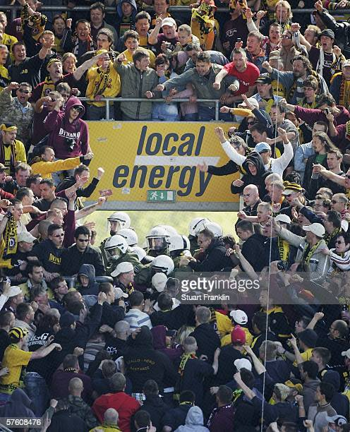 Riot police breakup a disturbance with Dresden fans during the Second Bundesliga between Hansa Rostock and Dynamo Dresden at the Ostsee Stadium on...