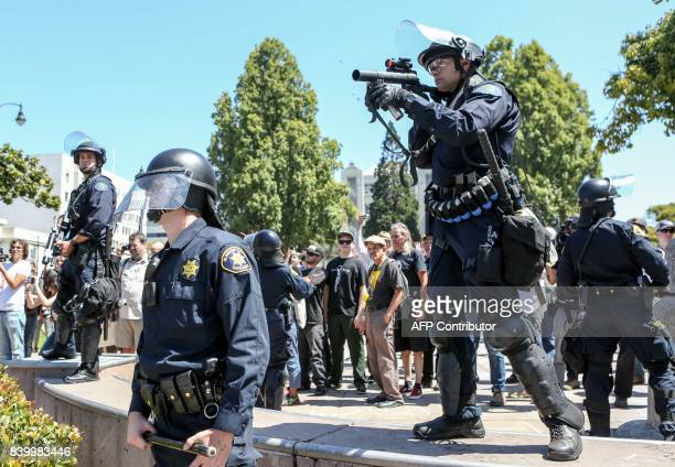 Riot police bring out tear gas guns during a rightwing No To Marxism rally on August 27, 2017 at Martin Luther King Jr. Park in Berkeley, California....