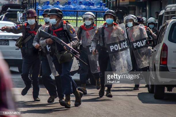Riot police charge at anti-coup protesters on February 27, 2021 in Yangon, Myanmar. Myanmar's military government has intensified a crackdown on...