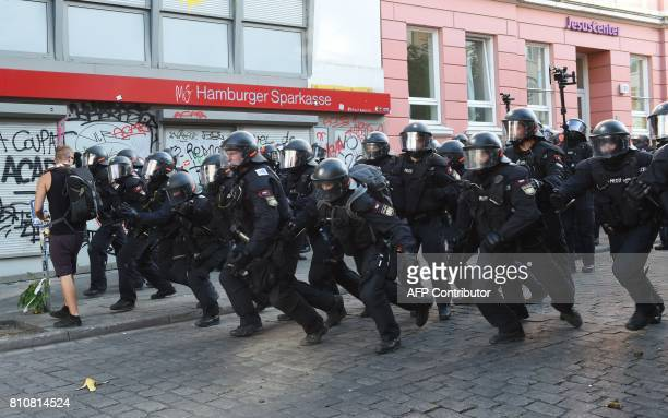 Riot police charge forward towards protesters on July 8 2017 in Hamburg northern Germany as world leaders meet during the G20 summit Raging street...