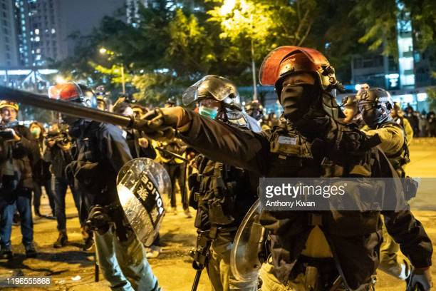 Riot police charge on a street during a demonstration in Fanling district on January 26, 2020 in Hong Kong, China. Protesters clash over a proposal...