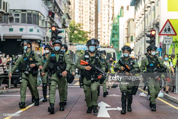 Riot police charge on a street during an antigovernment protest on September 6 2020 in Hong Kong China Nearly 300 people were arrested during the...