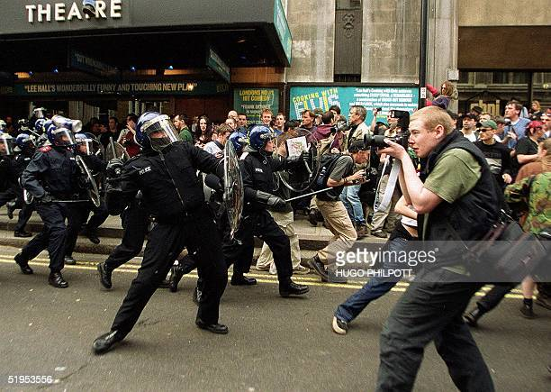 Riot Police charge protesters at Whitehall in central London after violence broke out near a Mcdonalds fast food restaurant during a May Day...