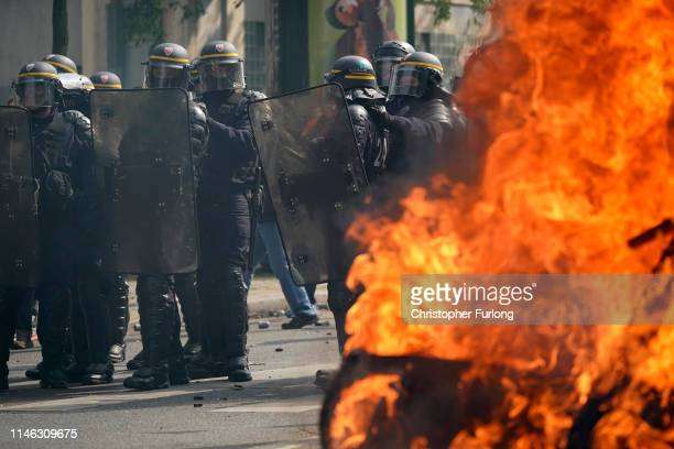 Riot police clash with demonstrators as they march though Paris during the annual May Day protests on May 01 2019 in Place D'Italie Paris France More...