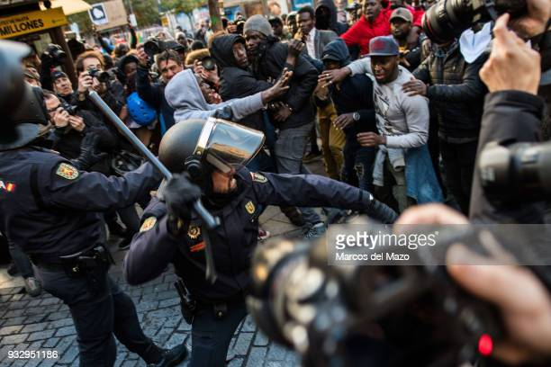 Riot police clash with demonstrators during a protest in support of Mmame Mbage a Senegalese street vendor who died the day before of cardiac arrest...