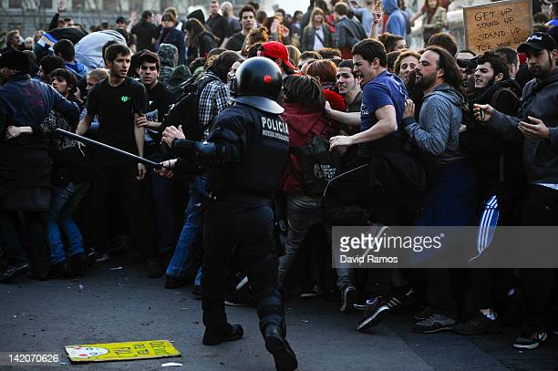 Riot police clash with demonstrators during heavy clashes with demonstrators during a 24hour strike on March 29 2012 in Barcelona Spain Spanish...