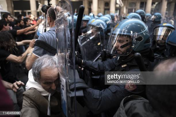TOPSHOT Riot police clash with No Tav movement demonstrators in Turin during one of several demonstrations against unemployment as part of May Day...