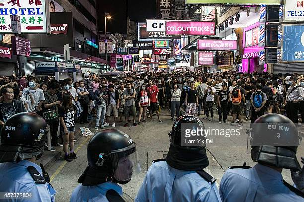 Riot police clash with protesters at Mongkok protest site after the crackdown at morning on October 17 2014 in Hong Kong Hong Kong Police have begun...