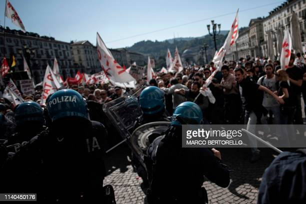 Riot police clash with protesters of the No Tav movement in Turin during one of several demonstrations against unemployment as part of May Day...