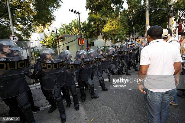 Riot police come face to face with teachers while their colleagues were negotiating the path of the march during a protest that gathered thousands of...