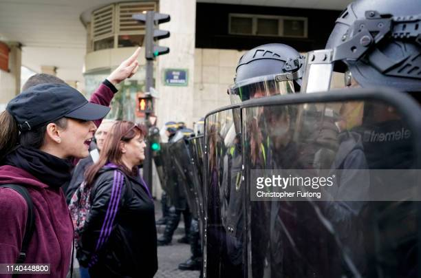 Riot police confront demonstrators as they march though Paris during the annual May Day protests on May 01 2019 in Montparnasse Paris France More...