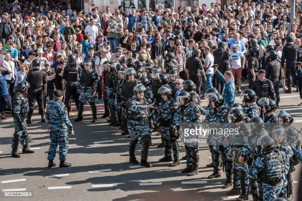Riot police controls manifestants against Putin during a demonstration in Moscow Russia on 5 May 2018
