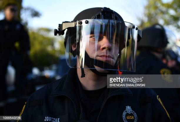 Riot police deploy as US President Donald Trump visits the Tree of Life Congregation on October 30 2018 in Pittsburgh Pennsylvania Scores of...