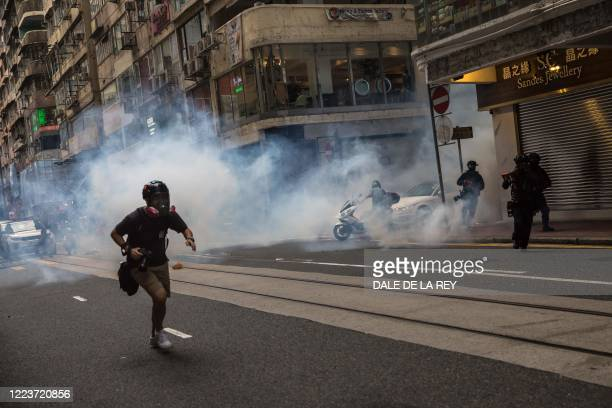 Riot police deploy tear gas as they clear protesters from a road during a rally against a new national security law in Hong Kong on July 1 on the...