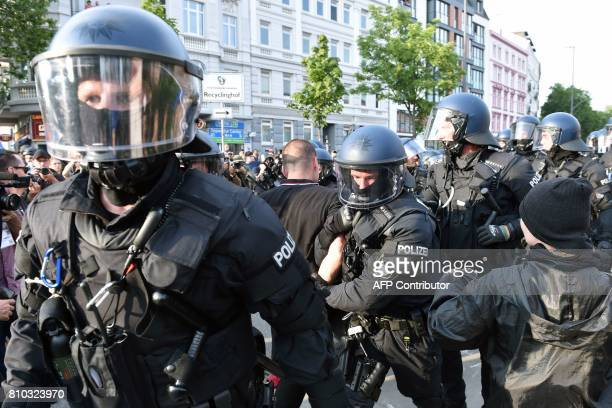 Riot police detain a demonstrator during a protest on July 7 2017 in Hamburg northern Germany where leaders of the world's top economies gather for a...