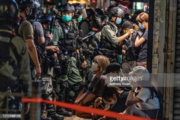 Riot police detain a group of people during an demonstration in Mongkok district on May 10 2020 in Hong Kong China Since the worst of the current...