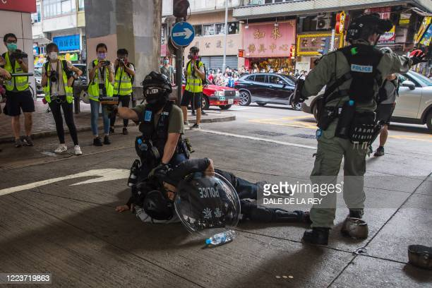 Riot police detain a man as they clear protesters taking part in a rally against a new national security law in Hong Kong on July 1 on the 23rd...