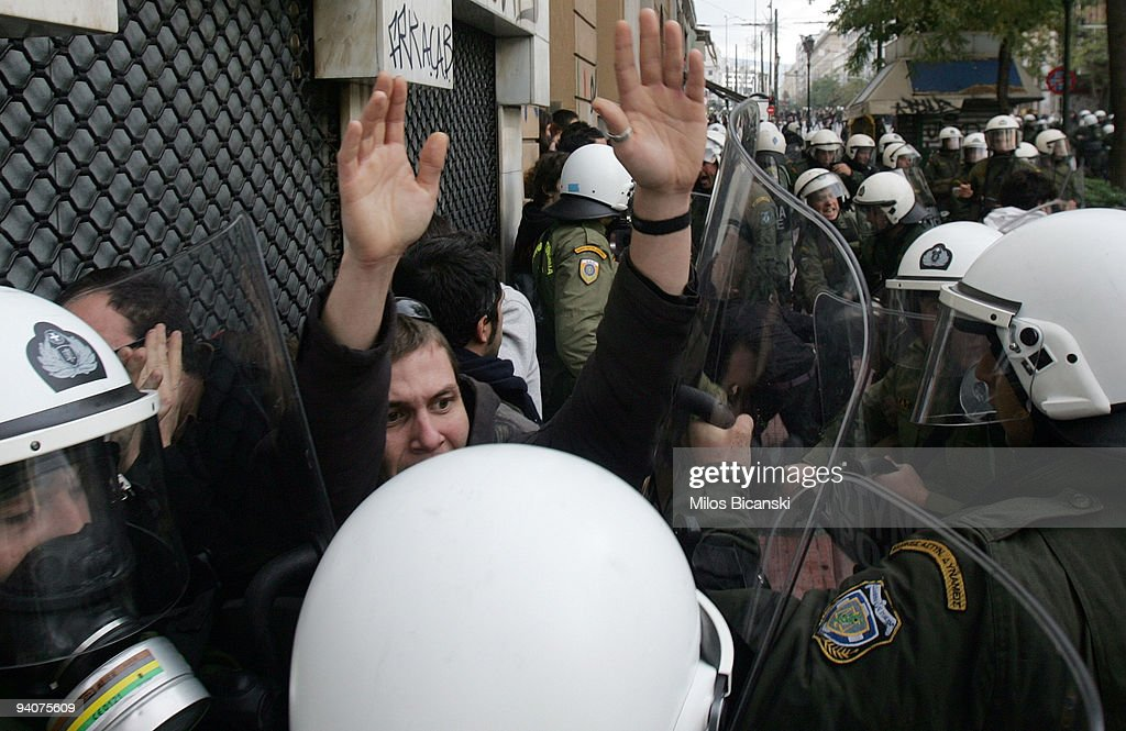 Riot police detain a protestors during a demonstration commemorating the fatal shooting of 15-year-old Alexandros Grigoropoulos' by police a year ago, on December 6, 2009 in central Athens, Greece. Two police officers will go on trial in the new year for the murder of Grigoropoulos.