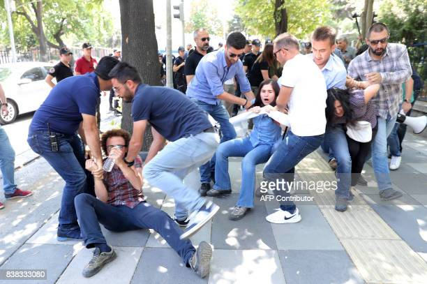 Riot police detain protesters during a protest against the detention of hungerstriking teacher Semih Ozakca and literature professor Nuriye Gulmen in...
