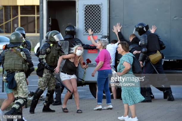 TOPSHOT Riot police detain protesters during a rally of opposition supporters who accuse strongman Alexander Lukashenko of falsifying the polls in...