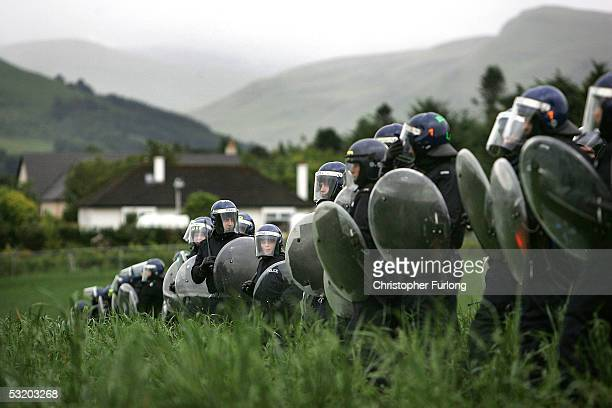 Riot Police disperse demonstators who breached the steel security fence surrounding Gleneagles on July 6 2005 in Auchterarder Scotland As The G8...