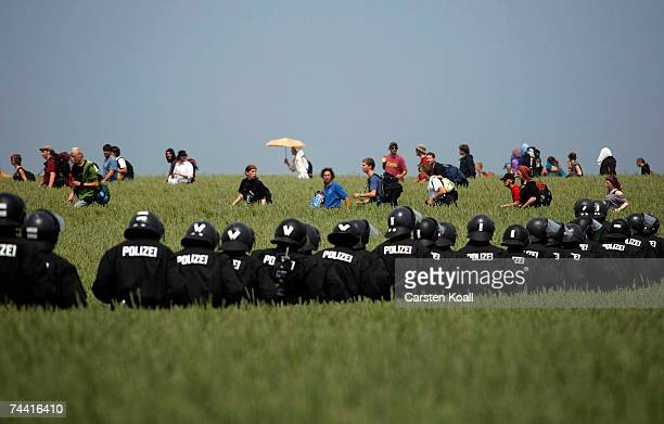 Riot police escort activists of the anti G8 forum Block G8 on a demonstration in a field on June 06 2007 in Boergerende close to Heiligendamm The...