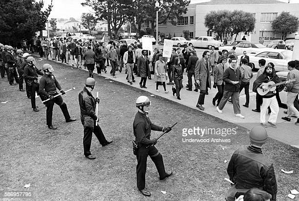 Riot police establish a line during the San Francisco State University student strike demonstration and subsequent riots, San Francisco, California,...