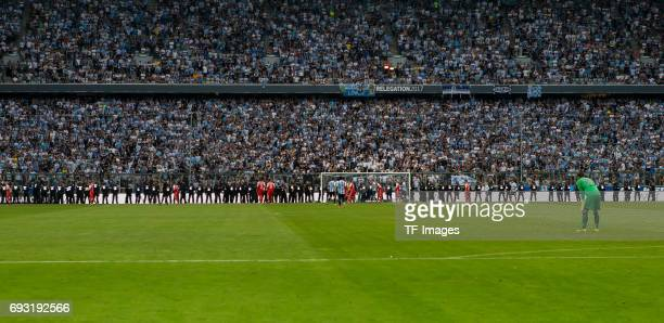 Riot police face 1860 Muenchen fans during the Second Bundesliga Playoff second leg match between TSV 1860 Muenchen and Jahn Regensburg at Allianz...