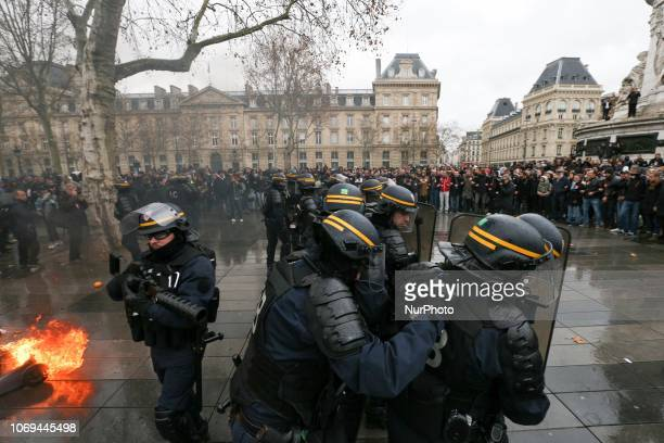 Riot police face high school students demonstrating in Place de la République in Paris on December 7 against educational reforms including university...