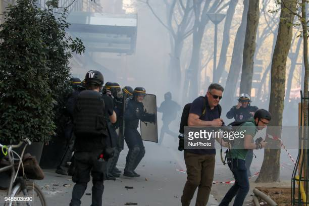 Riot police face off with protesters during clashes on the sidelines of a demonstration on April 19 2018 in Paris as part of a multi branch day of...
