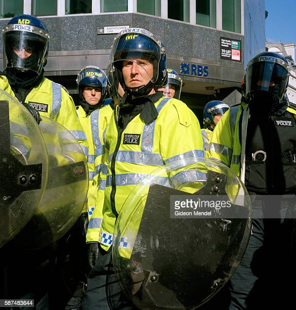 Riot police face protestors during the historic during the historic April Fools Day protest outside the Bank of England coinciding the G20 summit in...