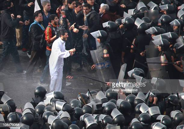 Riot police face protestors on the Kasr Al Nile Bridge on January 28 2011 in downtown Cairo Egypt Thousands of police are on the streets of the...