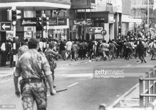 Riot Police fire on crowds using shotguns loaded with birdshot during a demonstration in central Cape Town South Africa 9th March 1976