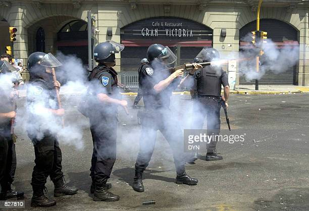 Riot police fire tear gas as they try to control a crowd of demonstrators December 20 2001 in Buenos Aires Argentina Anger over Argentina's deepening...