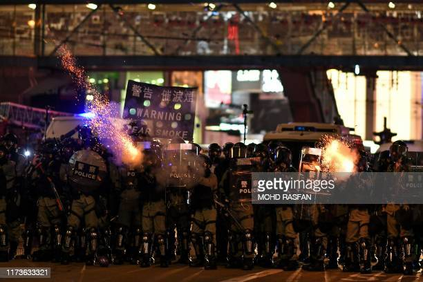 Riot police fire tear gas at protesters at Causeway Bay area in Hong Kong on October 4 as people hit the streets after the government announced a ban...