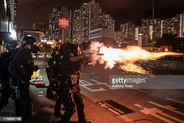 Riot police fire tear gas at protesters during a demonstration in Wong Tai Sin District on August 5 2019 in Hong Kong China Prodemocracy protesters...