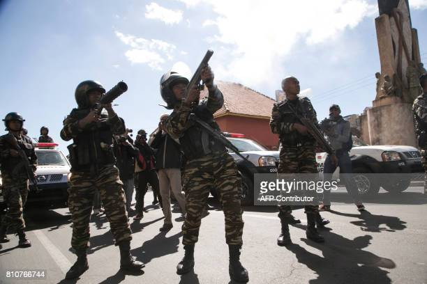 Riot police fire tear gas at supporters of Madagascar's opposition party Tiako i Madagasikara during a gathering for the party's 15th anniversary,...