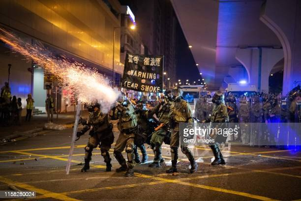 Riot police fire tear gas during a demonstration in the area of Sheung Wan on July 28, 2019 in Hong Kong, China. Pro-democracy protesters have...