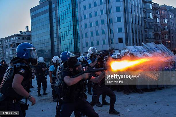Riot police fire tear gas to disperse the crowd during a demonstration near Taksim Square on June 11 2013 in Istanbul Turkey Istanbul has seen...