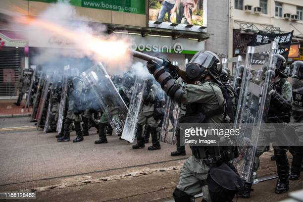 Riot police fire tear gas towards protesters in the district of Yuen Long on July 27, 2019 in Hong Kong, China. Pro-democracy protesters have...